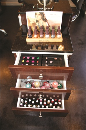Polishes that are not displayed on the salon walls are conveniently tucked away in custom-made drawers sitting beside the manicure stations.