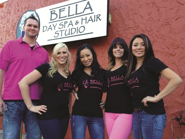 <p>Ryoko (center) with team members at Bella Day Spa</p>