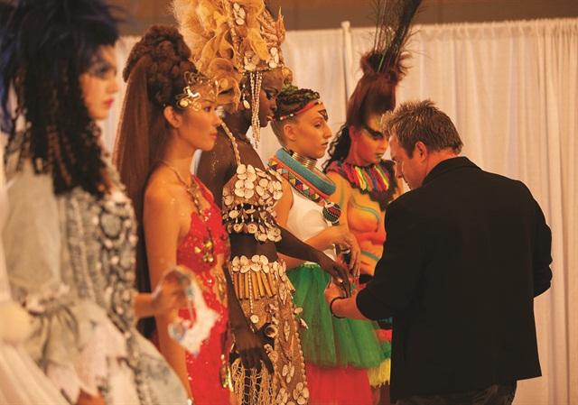 <p>John Hauk closely scrutinizes the contestants' nails.</p>