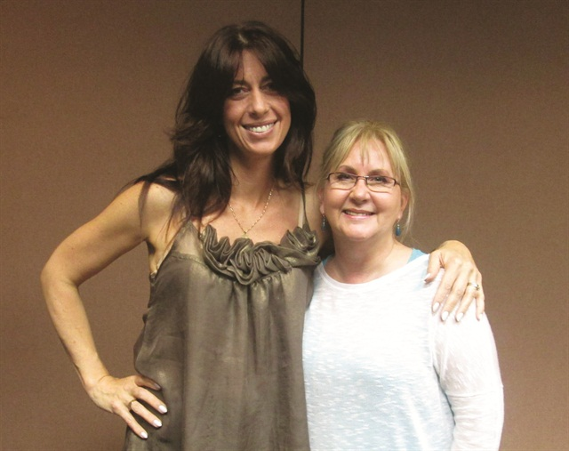 <p>Vickie Meador (right) turned to Amy Becker for advice on her guitarist client's nails. The two are seen here at a class Becker offered at the Nail Tech Event of the Smokies.</p>