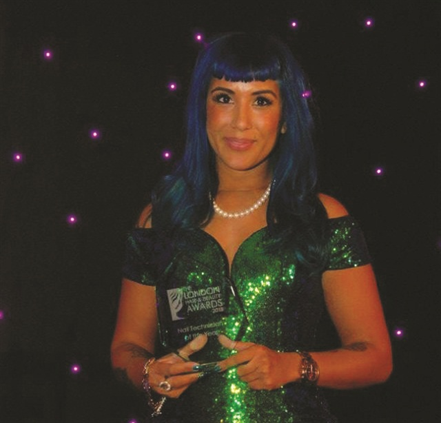 <p>Decadent Digits owner Sheena Allykhan accepts the Nail Tech of the Year award at the 2015 London Hair and Beauty Awards.</p>