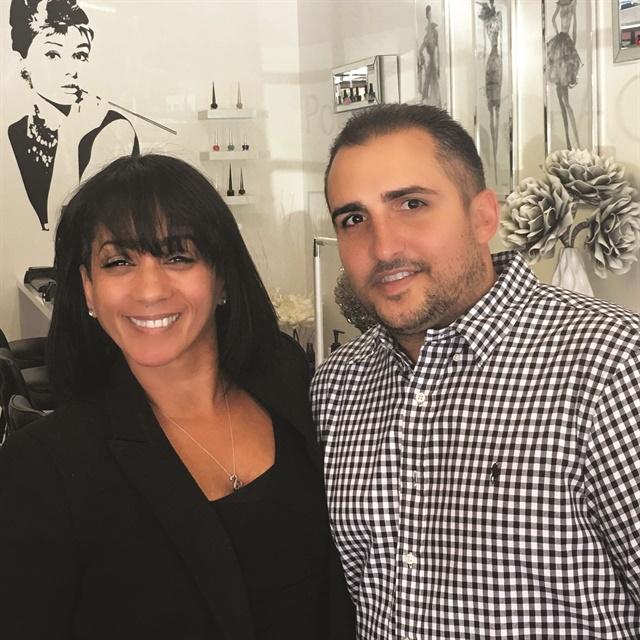 <p>Anthony poses with salon owner Lori Cuevas.</p>