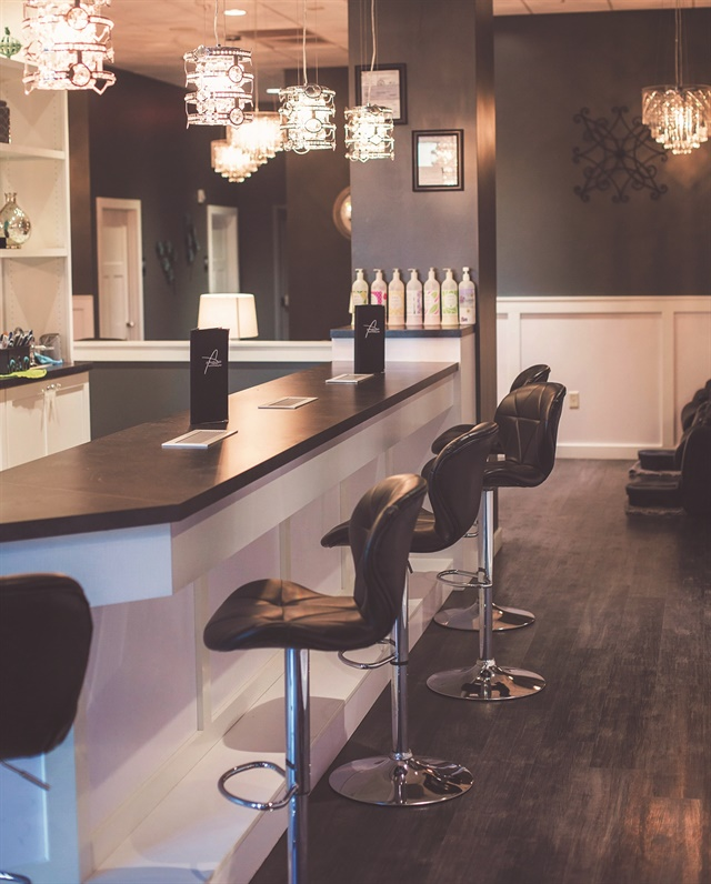 <p>Owner Canada Lytle wanted her salon to resemble a bar, complete with black leather stools and restaurant-quality check presenters.</p>