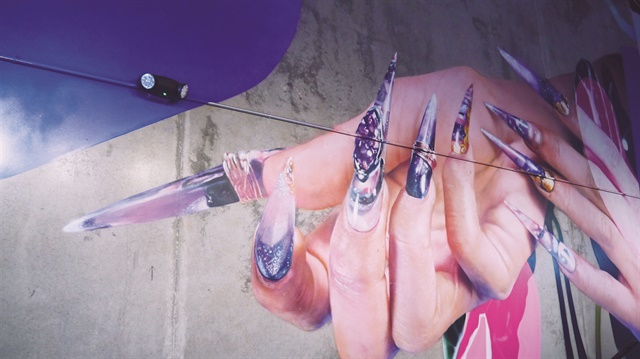 <p>Xue hired a locally known hyperreal artist to paint this nail mural.</p>