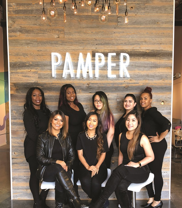 <p>Xue (center back) poses with the Pamper techs, who went through a boot camp to perfect the craft of sculpting nails.</p>
