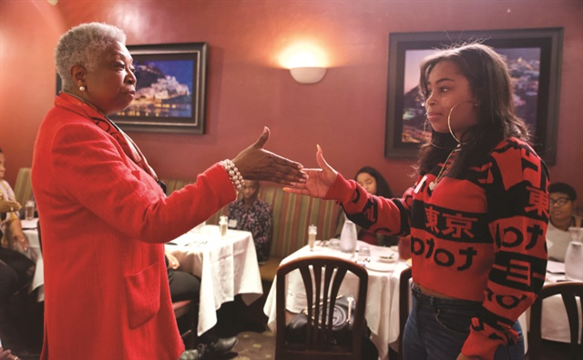 Program participants learn proper etiquette, including businesslike handshakes.