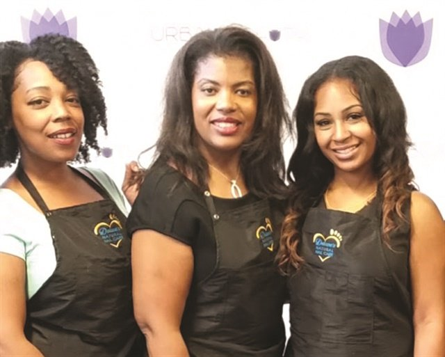 <p>Trainer Khiana Block, Delane Sims, and assistant director Myeshia Jefferson pose for the camera.</p>