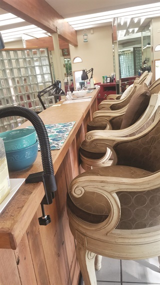 <p>The nail bar was built with recycled wood from pallets. The top is cork flooring, which is stain- and acetone-resistant.</p>