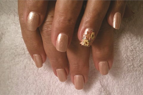 <p>Michelle Aab, technical advisor with Nubar Cosmetics, creates floral nail art for her clients using silk wraps.</p>