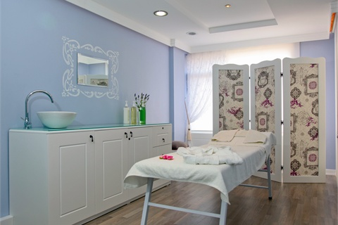 Misk's treatment rooms incorporate  soothing colors and feminine details, as well as folding screens for  added privacy.