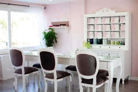 <p>The manicure area seats three clients at a time on Misk's specially designed wooden manicure table near one of the larger windows.</p>