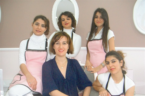 <p>Owner Ceren Ergun (center) and her staff work together to maintain    the best standards in luxury nail services and client care possible.</p>