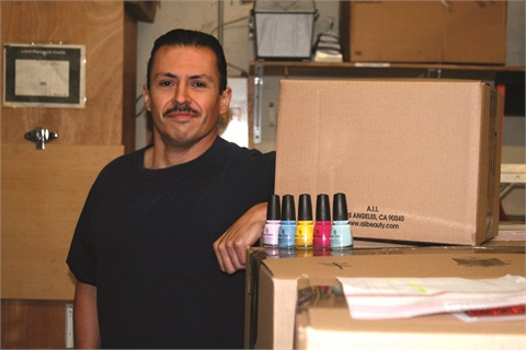 "<p>A.I.I.'s Gerardo Chavez, aka ""Gery the Shipping Guy"" works in the shipping and receiving department for the company, while also promoting China Glaze and other A.I.I. brands with his talent for nail art.</p>"