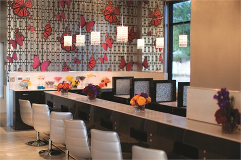 <p>This custom-built drying bar and manicure area is a friendly place where clients can relax before heading home. There is also a complimentary candy bar offering various snacks for clients to munch on.</p>