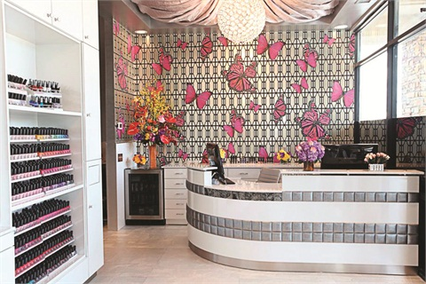 <p>The front reception area of Isle Pedi Spa's Memorial location has a clean and sophisticated look. The white walls, cabinets, and desks are balanced with splashes of bright pinks, purples, oranges, and silver.</p>
