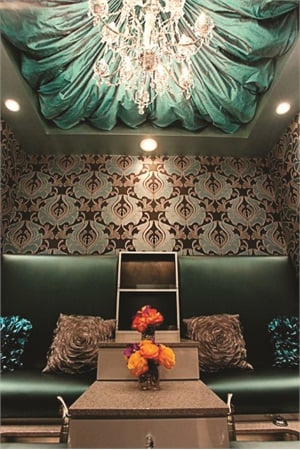 "<p>The ""romantic suite"" offers privacy and coziness. Large pillows and padded seats line the walls, while a hand-picked warm color scheme focused on shades of teal and gold.</p>"