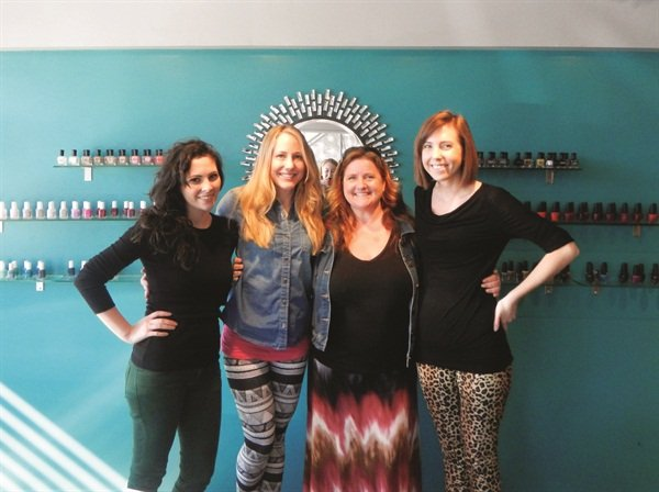 <p>Nail artists Maddie Wheeless-Hoff (left) and Sarah Kane (right) were gracious hosts for my friend Alison Ewing (second from left) and me.</p>