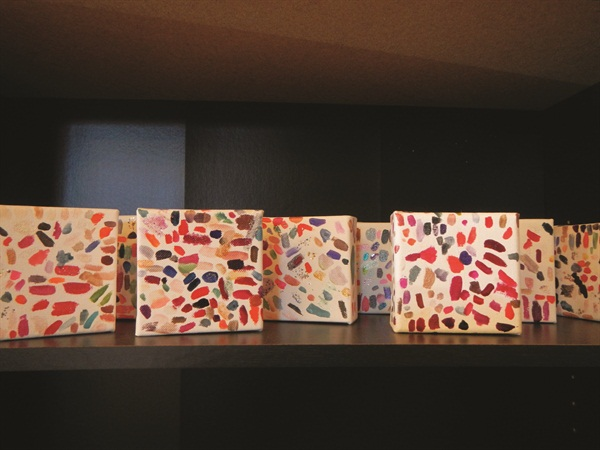 <p>I love these canvasses where clients can sample the different polish colors. After the canvas is full, it's displayed around the salon as art.</p>