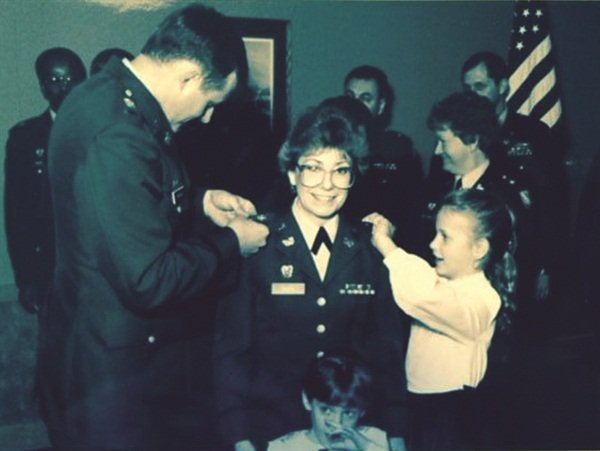 A young Jen McClain helps out at her mom's promotion ceremony