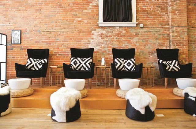 Black velvet chairs match the color scheme of Lacquer Gallery perfectly, and ensure a comfy and stylish pedicure.