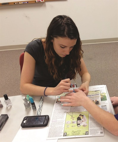 Celine Cumming teaches nail art classes for preteens and teens at local libraries in Delaware.