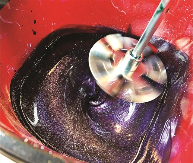 <p>After applying pigments, glitters or micas to a suspension base, Chheo-Shen mixes them to form one uniform color in a large bucket with a paint mixer on a drill.</p>