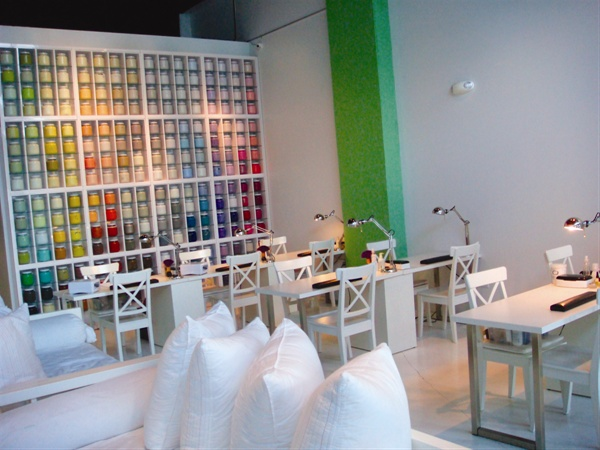 <p>Christine and Eduard Joseph, owners of Nailbar in Midtown Miami, opted to use concrete for their flooring and non-toxic paint for their walls and displays. Furniture is made from recycled wood, so the salon can boast that whatever a client touches in the salon is natural and toxic-free. The salon offers gel enhancements, but not acrylic.</p>
