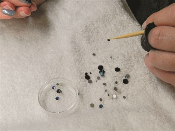 <p>Franklin brought rhinestones in practically every shape, size, and color. She used a variety of sizes and shades of blue for our raindrop nails.</p>