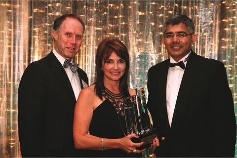 <p>Elmien Scholtz, founder of Bio Sculpture Gel, displays her Ernst & Young Entrepreneur of the Year Award.</p>