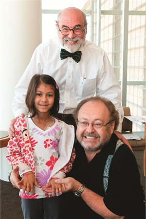 <p>George Schaeffer (right) and Dr. Michael Friedman, president and CEO of City of Hope, pose with a patient.</p>