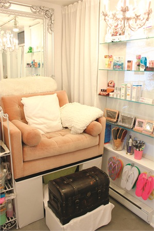 """<p class=""""NoParagraphStyle"""">Almost every piece of decor in The Studio — including the curtains and wall embellishments — is white, except for a few accent pieces, such as these velvet champagne-colored pedicure chairs.</p><p class=""""NoParagraphStyle""""></p>"""