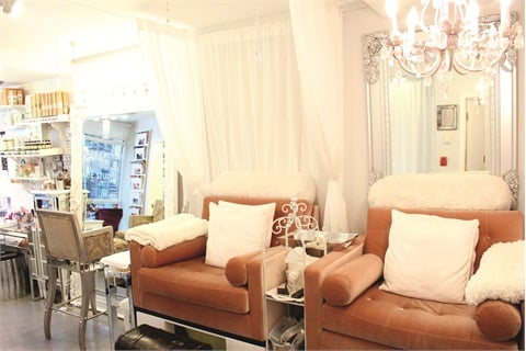 """<p class=""""NoParagraphStyle"""">The 800-sq.-ft. salon is lined with floor-length mirrors to open up the space.</p>"""