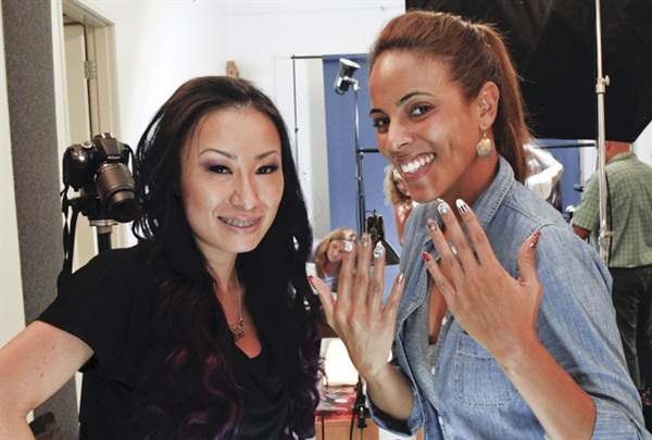 <p>Florida-based cover tech Ryoko Garcia (left) was flown to California as part of her prize package for winning NAILS Next Top Nail Artist. She dazzled model Ariel Paredes with her intricate handpainting.</p>