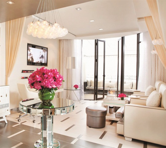 The salon's modern and elegant space is intimate with only three pedicure chairs and one manicure table.