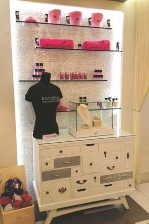 Fun goodies like flip-flops, foot balm, jewelry, and bedazzled t-shirts fill the retail boutique.