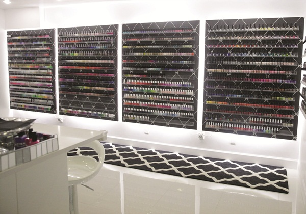 <p>Clients have an entire wall of colors to choose from including the famous (and expensive) Louboutin polish collection.</p>