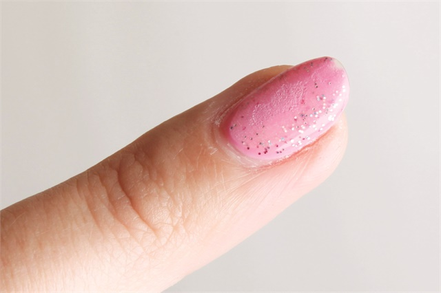Neither breaking the seal nor removing top coat are accomplished by filing only in the center of the nail.