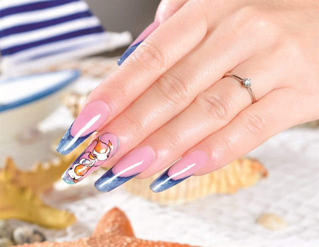 Nail tech Barbara Vespa of Claro, Switzerland, used gel to create this  elegant, colorful fish design. Follow her on Instagram. - Little Fish Nail Art - Style - NAILS Magazine