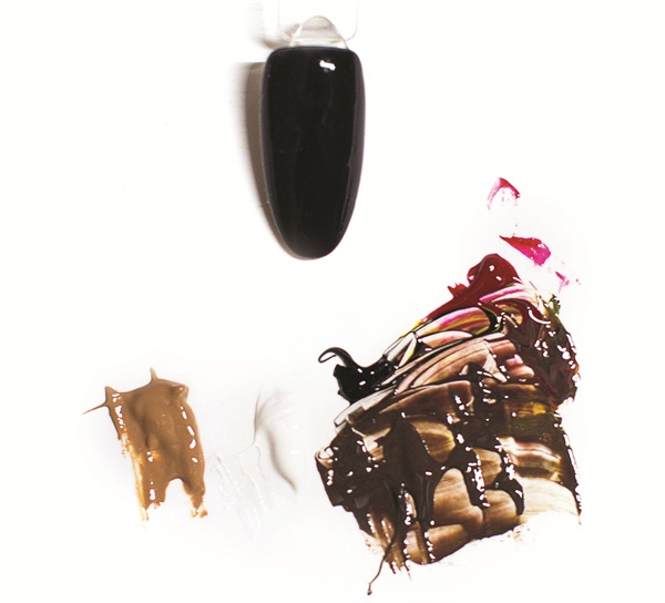<p>1. Prep the nail, and then coat it in a layer of Only Onyx. Collect a small portion of AnGel Artist Gel from each color pot and mix them to get the proper brown. As shown, Chen mixed brown with a black and a bit of both red and yellow to create a richer shade of tan.</p>