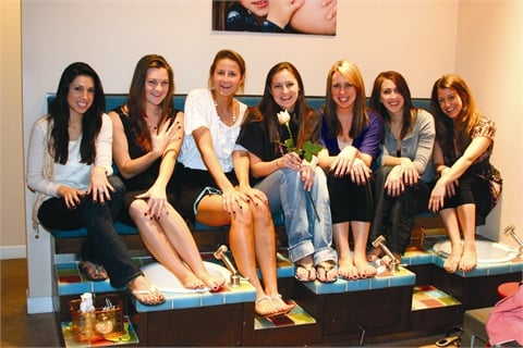 As the party winds down, bridesmaids (from left to right) Kailey  Latteri, Kinsey Cronin, Kate Silvey, Anne Silvey (bride), Julie  Phillips, Anna Jones, and Catherine Herzog show off their freshly  polished hands and feet.