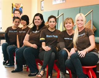 From left to right, nail techs Jolene Le, Pei Lee, Lisa Lucerne,  Brenda Iniguez, Janet Herman, and Melisa Bruce man their pedi stools in  anticipation of the arriving party.
