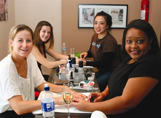 <p><em>Maid-of-honor Kate Silvey (foreground) gets a manicure with  LaShauna Theone while easily being able to chat with bridesmaid Kinsey  Cronin (getting a manicure with Jolene Le).</em></p>