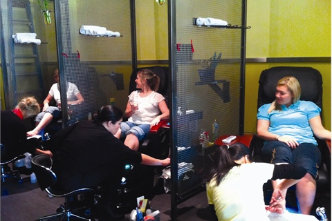 <p>Though screens separate clients at The Nail Bar in Dallas, clients can still enjoy interacting with friends during their pedicure appointment.</p>