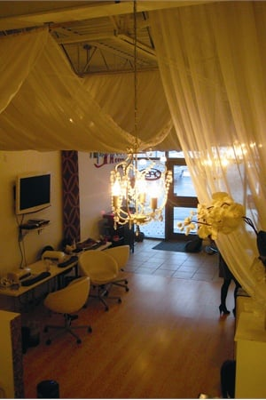 <p>The high ceilings, warm lights, and soft draping add to the sweet, relaxing ambiance in the space.</p>