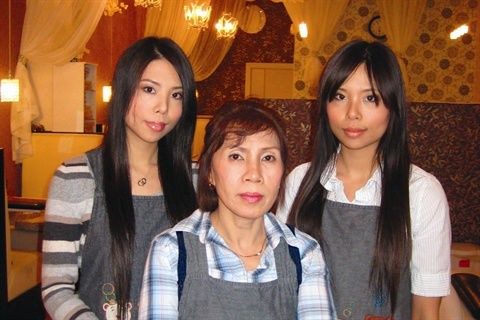 <p>(left to right) Owner Thao Nguyen stands with her mom, Be Thi Nguyen, and sister/business partner Ha Nguyen in their salon's main foyer. The sisters created the salon from the ground up, which included everything from negotiating with contractors to laying down tile and flooring themselves.</p>