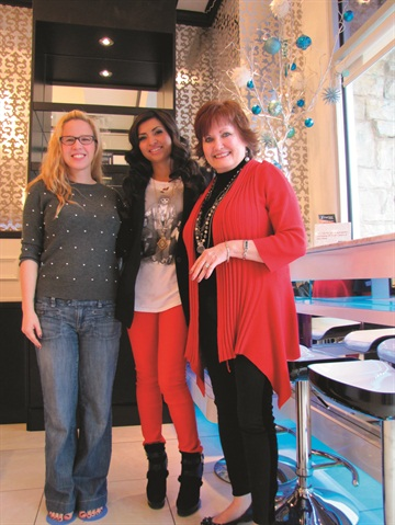 <p>In addition to managing the salon, Victoria Tran (middle) is in five days a week performing services.</p>
