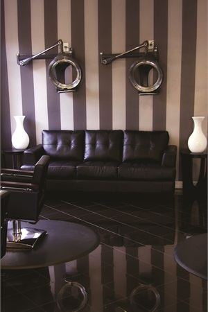 <p>The waiting room features black leather couches, marble floors, and modern light fixtures. Silacci describes the salon as having an upscale feel with a relaxed attitude.</p>