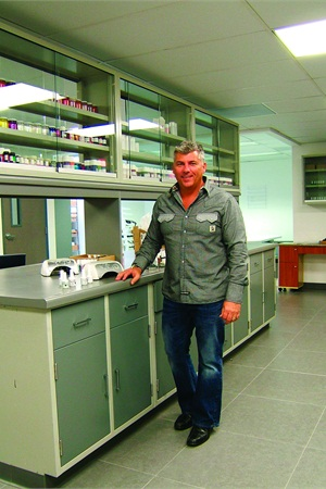 <p>Hand & Nail Harmony CEO Danny Haile stands in his new chemistry lab. All the new shades of Gelish as well as hard gels like Reveal are tested and finalized here.</p>