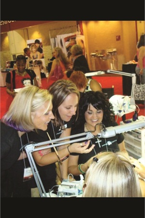 <p>Melissa De La Cruz (right) with the ProFiles girls at a beauty expo in Florida.</p>
