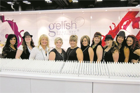 <p>MaeLing Parrish (fifth from left) and company working at a tradeshow in Austin, Texas take time to pose for the camera.</p>